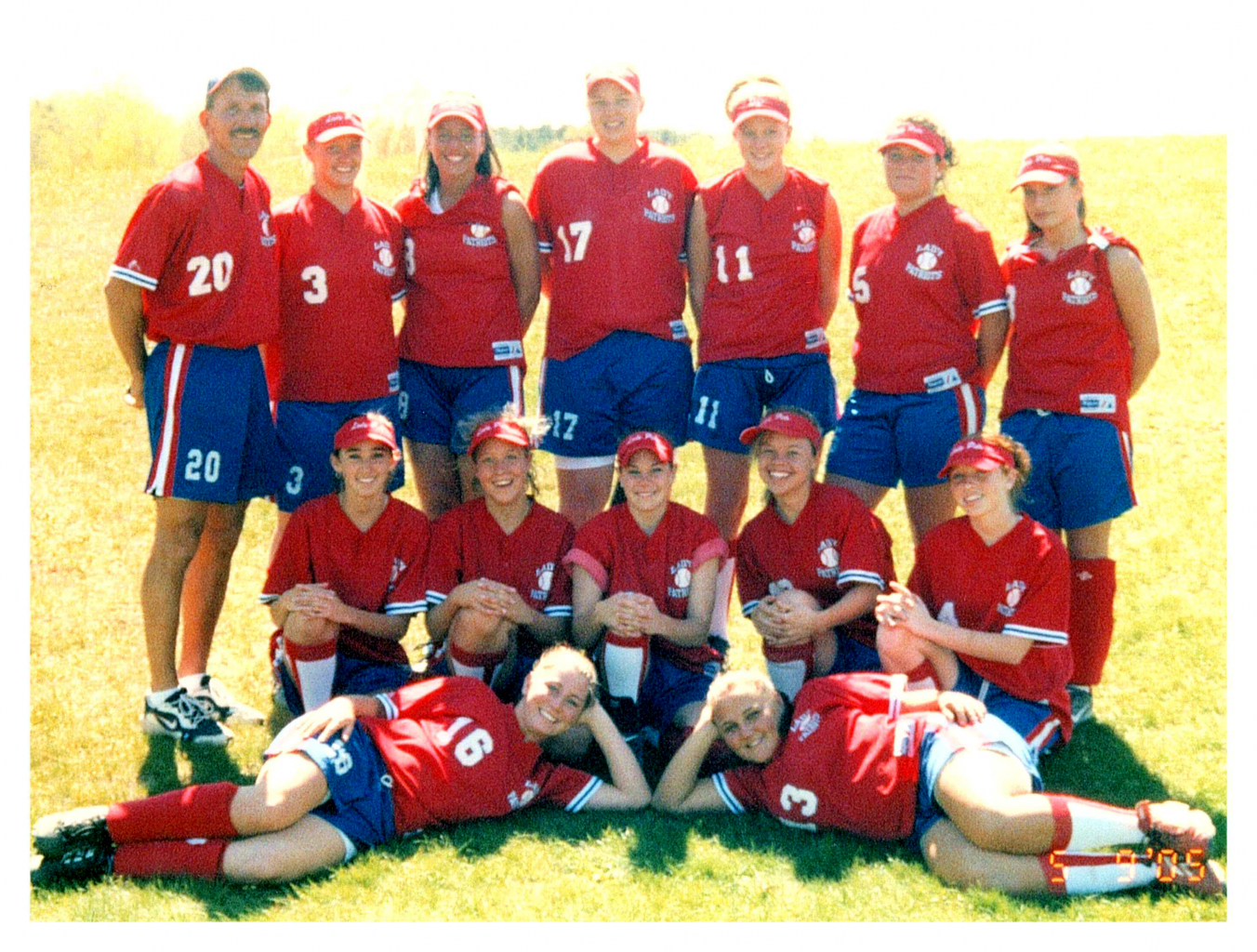 Team photo of 2005 B-P Varsity Softball in three rows. Players are wearing caps, red shirts and blue shorts