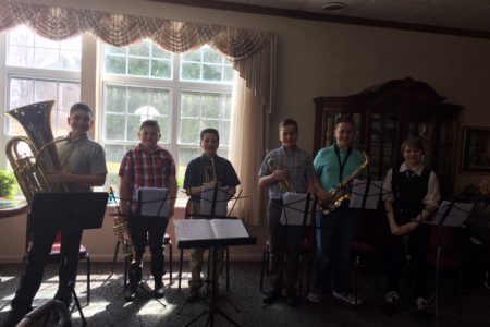 Student musicians perform at nursing home