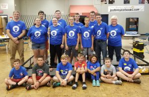 students attending the summer robotics camp pose for a picture