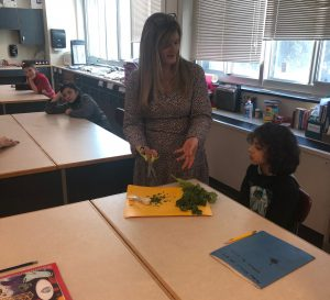 jodie fitz speaks with a cooking club student