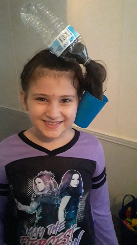 girl with a water bottle pony tail