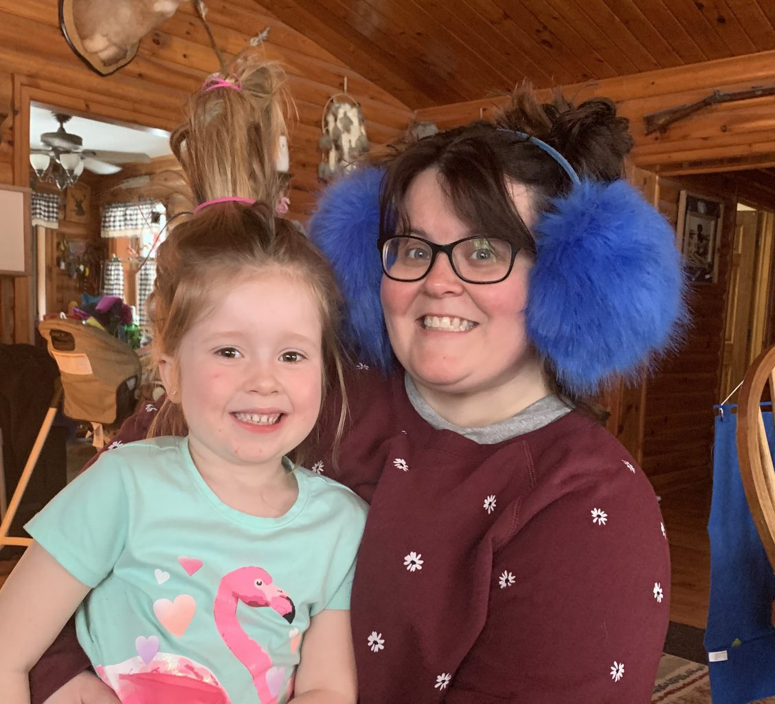 mom and daughter with huge fuzzy earmuffs