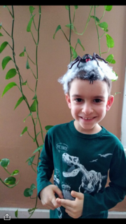 boy with huge spider and web on his head