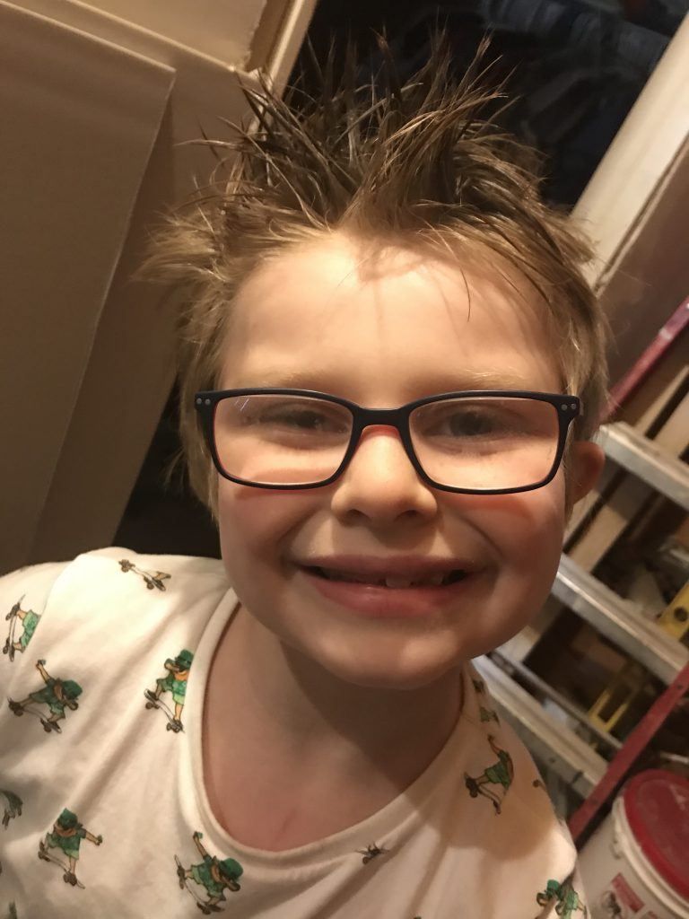 child with spiked hair and glasses