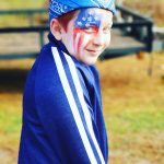 boy with American flag painted on his face