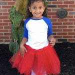 girl in BP colors wearing a red tutu