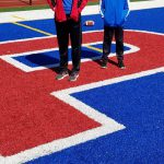students standing on Patriots field