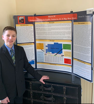 Owen Compani stands by his project display