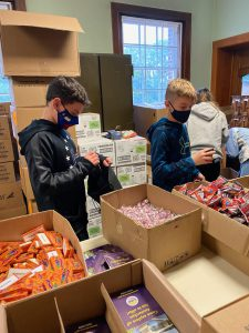 BP students sort through boxes of Halloween candy to help the City of Amsterdam prepare for a drive-thru trick-or-treat event on October 31.