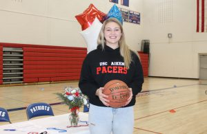 Makenzie Smith holds a basketball in the B-P high school gymnasium