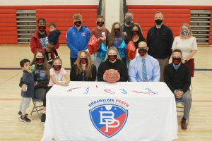 Makenzie Smith poses with her friends, family, coaches and teachers to celebrate signing a National Letter of Intent to play division 2 basketball at the University of South Carolina Aiken.
