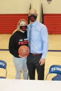 Makenzie Smith poses with B-P athletics direct and varsity girls basketball coach Tucker Gifford