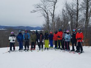 Members of the B-P alpine ski team pose at the top of their home course at Oak Mountain, during a recent practice.