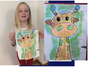 a young art student shows her creation of a hand-drawn giraffe.