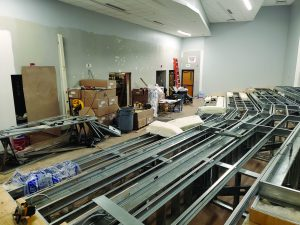 The former cafeteria at the high school is shown under construction, being turned into a tiered seating lecture hall.