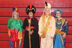 four characters from the show Aladdin Kids pose in their show costumes