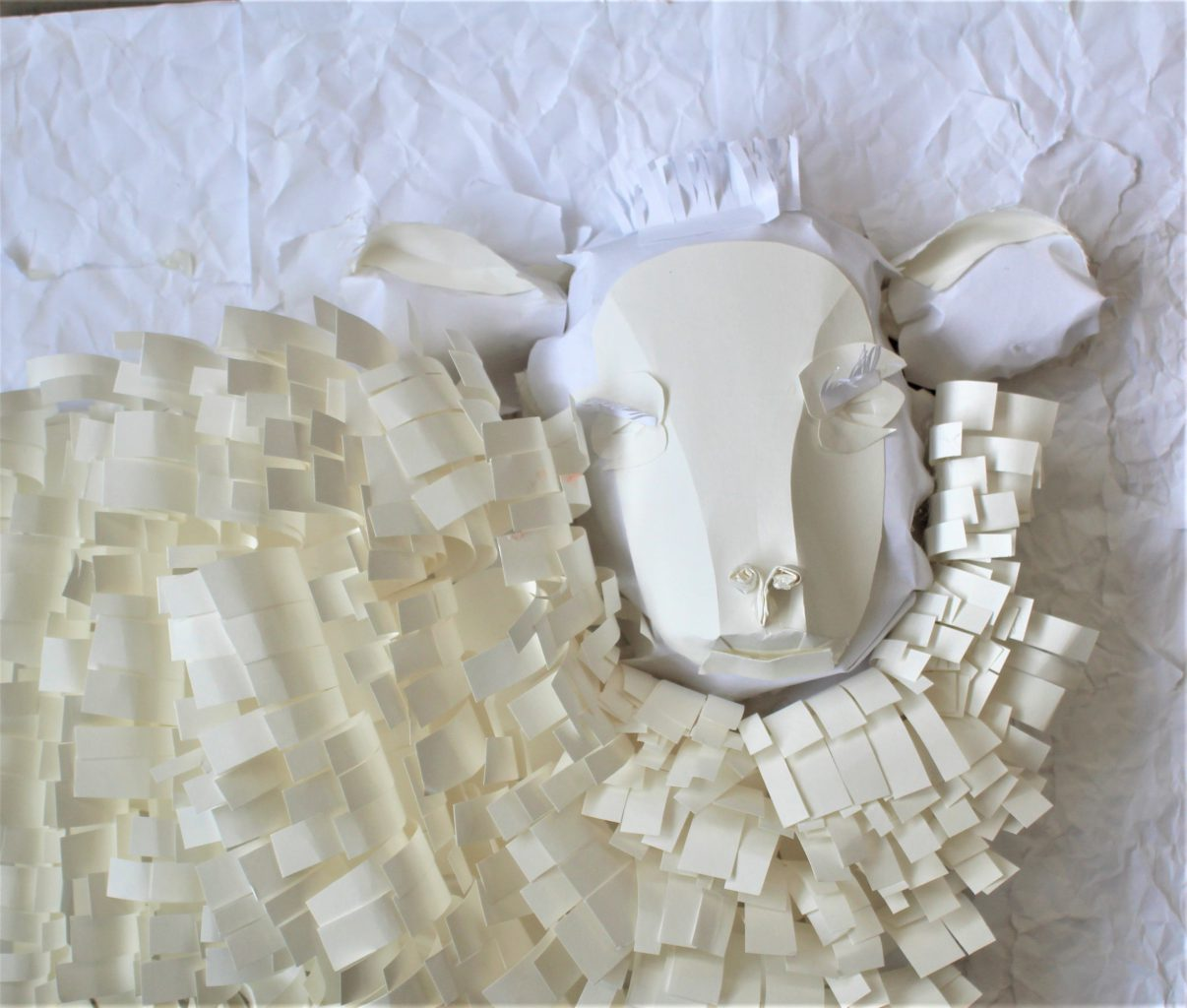 a sheep is made from curled pieces of paper