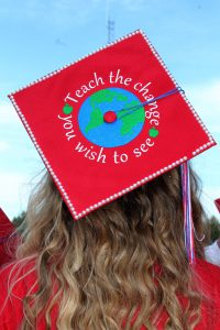 """a graduation cap is decorated with a blue and green globe and the saying """"teach the change you wish to see"""""""