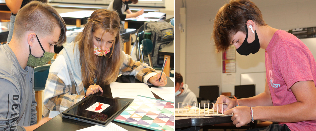 a male and female student work together on a science lab; a male student wearing a face mask builds a small bridge out of wood
